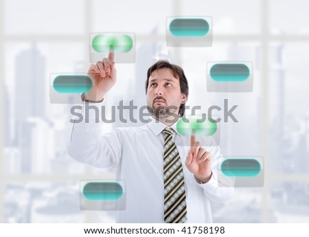 Young male person pressing digital buttons on touchscreen