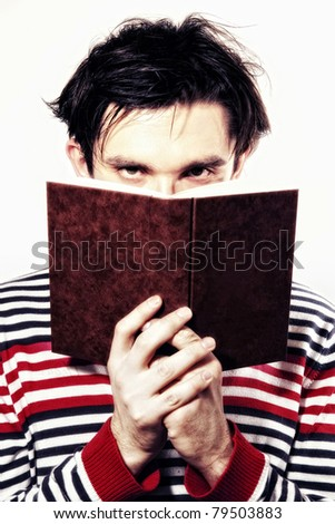 young man reading  book on white background