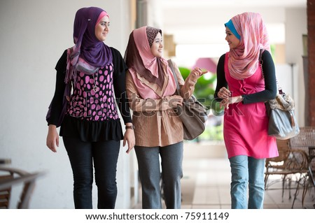 Young Muslim Woman In Head Scarf Walk Together Stock Photo 75911149  Muslim Head Scarves Women