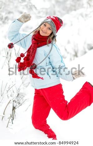 young playful woman enjoying the snow