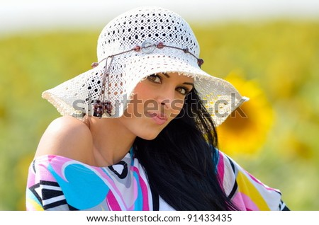 young pretty woman on field in summer