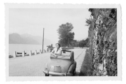 1950 Young woman and car in Italy