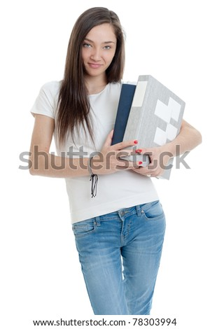Young woman carrying a pair of thick books