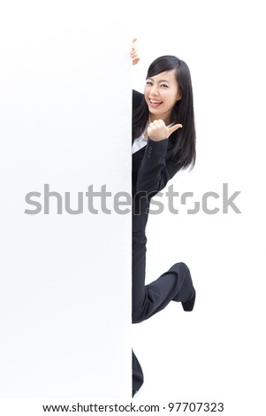 young woman giving thumbs up and holding blank billboard, isolated on white background