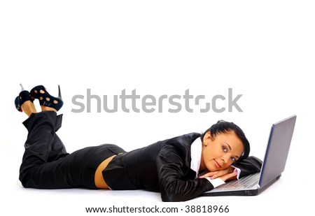 young woman is lying on the floor and working on a laptop