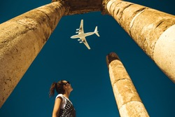 Young woman look at airplane dreaming about vacation. Explore the world. Export concept. Time to travel. Freedom life. Independent person. Tourism and transportation industry. Spirit of adventure.