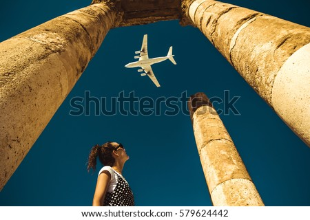 Young woman look at airplane dreaming about vacation. Explore the world. Export concept. Time to travel. Freedom life. Independent person. Tourism and transportation industry. Spirit of adventure. #579624442