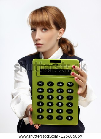 Young   woman with a green  big calculator in her hands