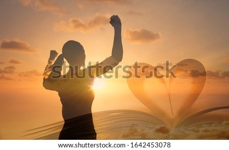 Young woman with arms flexed up to the sky. Religious symbol, worship, self belief, life goals concept.    商業照片 ©