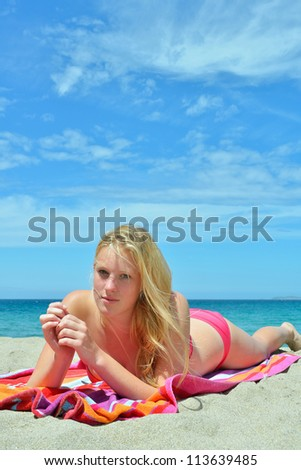 young women sunbathing on the beach