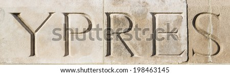 'YPRES' carved in stone at Tyne Cot War Cemetery, Flanders, Belgium.  Commemorating World War One  Stock photo ©