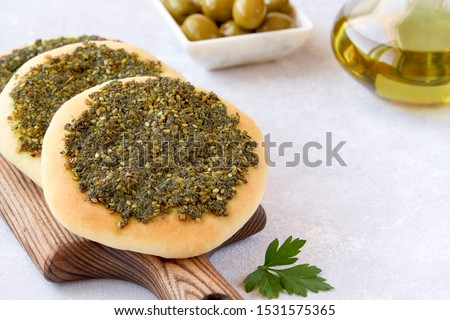 Zaatar manakeesh with olives and olive oil . Close up                           Stock photo ©