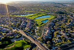 a aerial high definition shot of a golf course in Arizona during the winter.