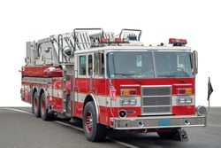 a american fire engine on a road, partly isolated