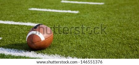 A American football on a green football field