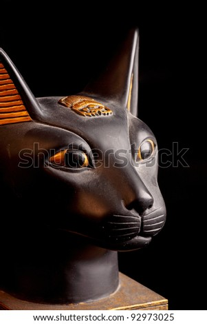 a antique cat statue on the black