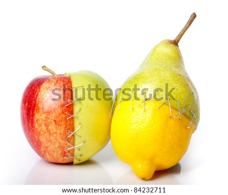A apple, pear and lemon putted together like Frankenstein