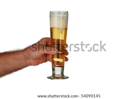 a arm holds a glass of beer isolated on white