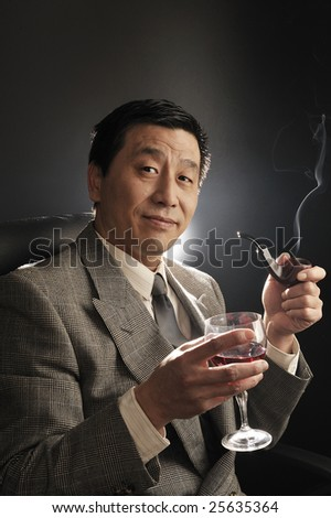 A Asia businessman Confidence smiling and smoking