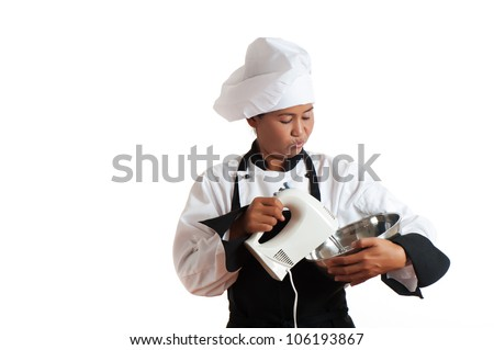 A asian woman as restaurant chef mixing something with a mixer in a bowl