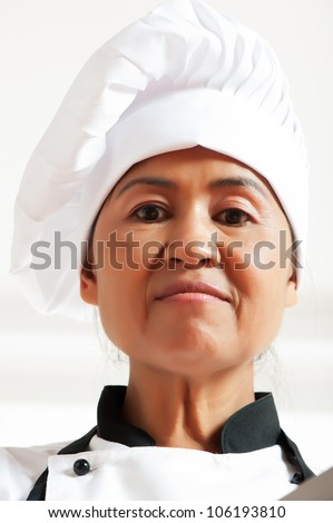A asian woman as restaurant chef on white background