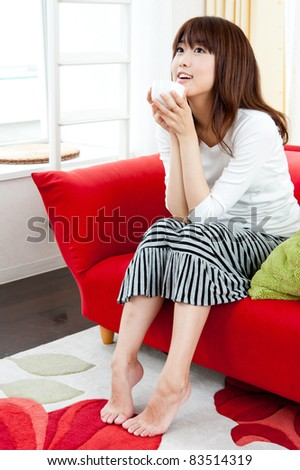 a attractive asian woman relaxing in the living room