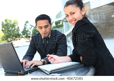 A attractive man and woman business team at office with laptop computer