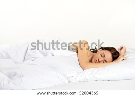 a attractive young woman is sleeping in her bed