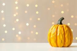 A autumn pumpkin on a shiny light background