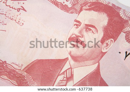 A Ba'athist era 5 dinar Iraqi banknote, showing the image of deposed leader Saddam Hussain