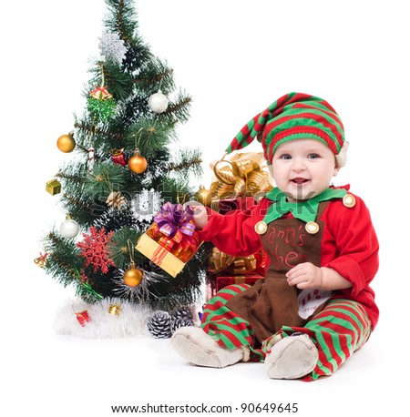 A baby dressed as a elf.  isolated.