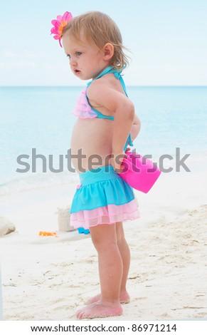 a baby girl on the beach