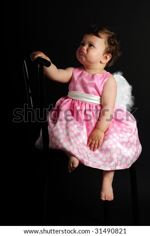 baby girl angel. stock photo : A aby girl