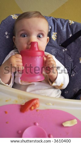 A baby is eating lunch.