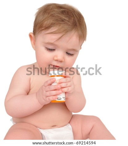 A baby is sitting on the floor on a white background and playing with a prescription pill bottle. Use it for a addiction or parenting concept.