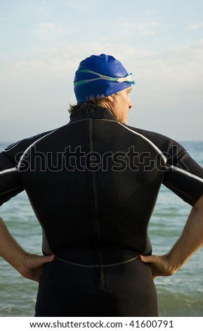 A back view of a muscular male triathlete or swimmer looking to the side #41600791