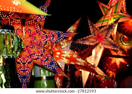 A backgorund with a view of beautifully designed colorful lanterns (also locally called as skylanters) decoration lit of the occasion of Diwali / Christmas festival in India.
