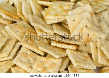 A background consisting of a bunch of mini saltine crackers.