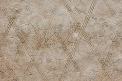 A background consisting of geometric shapes. A wall of rhombuses