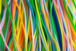 A background from colourful plastic toy cables