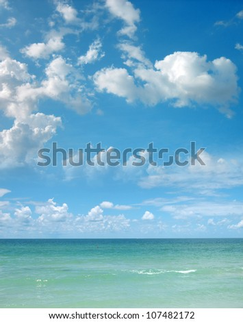 a background image of an open sea and blue sky