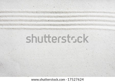 A background image with white sand and a raked stripe