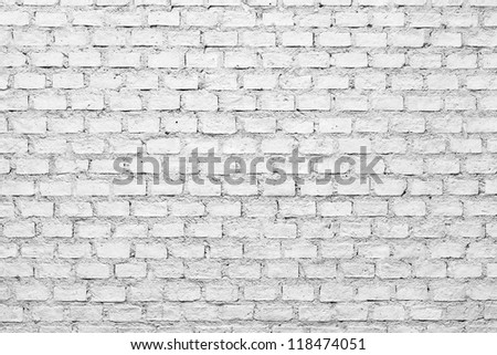 a background of a white brick wall