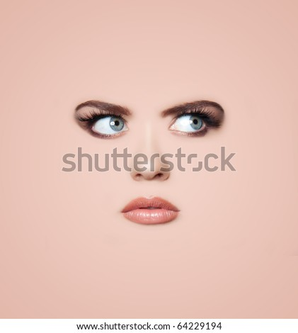 A background of a woman's face.