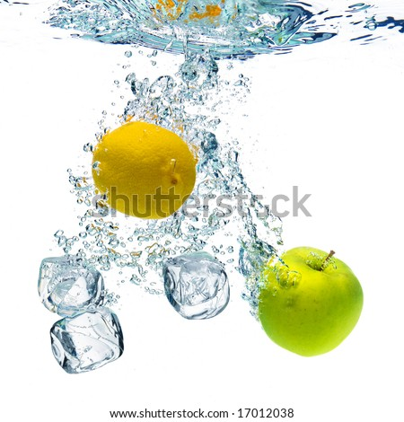 A background of bubbles forming in blue water after ice cubes, lemon and apple are dropped into it.
