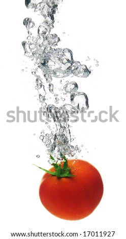 A background of bubbles forming in water after tomato are dropped into it.