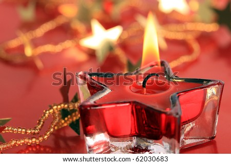A background of Christmas stars and candle