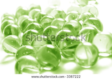 A background of colourful glass marbles. Green version