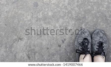 A background of gray floor and gray and black sneakers with room for copy #1419007466