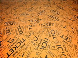 A background of orange vintage style tickets. For movie, concert, plays, and carnivals.